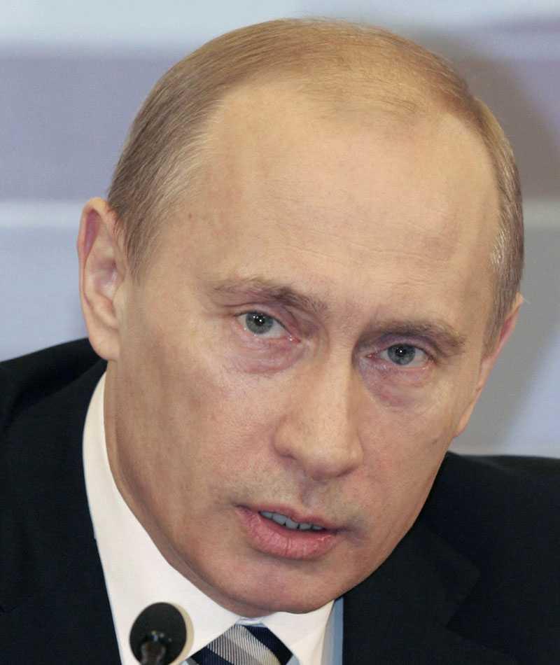Rysslands president Vladimir Putin vid den årliga jättepresskonferensen i Kreml. Han hotade bland annat med att rikta raketer mot Rysslands grannländer.