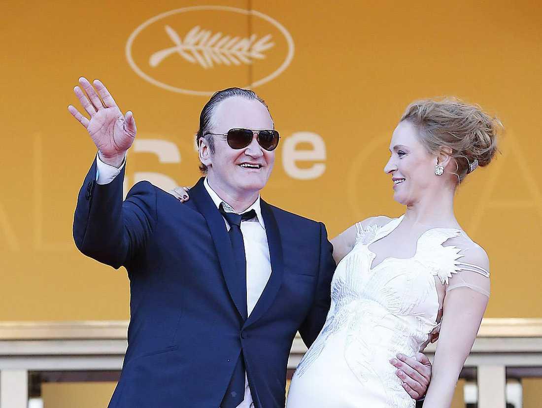 """Quentin Tarantino och Uma Thurman på röda mattan inför årets utdelning av Guldpalmen. Tarantino visade """"Pulp fiction"""" gratis på Cannes strand - och ställde till med kaos."""