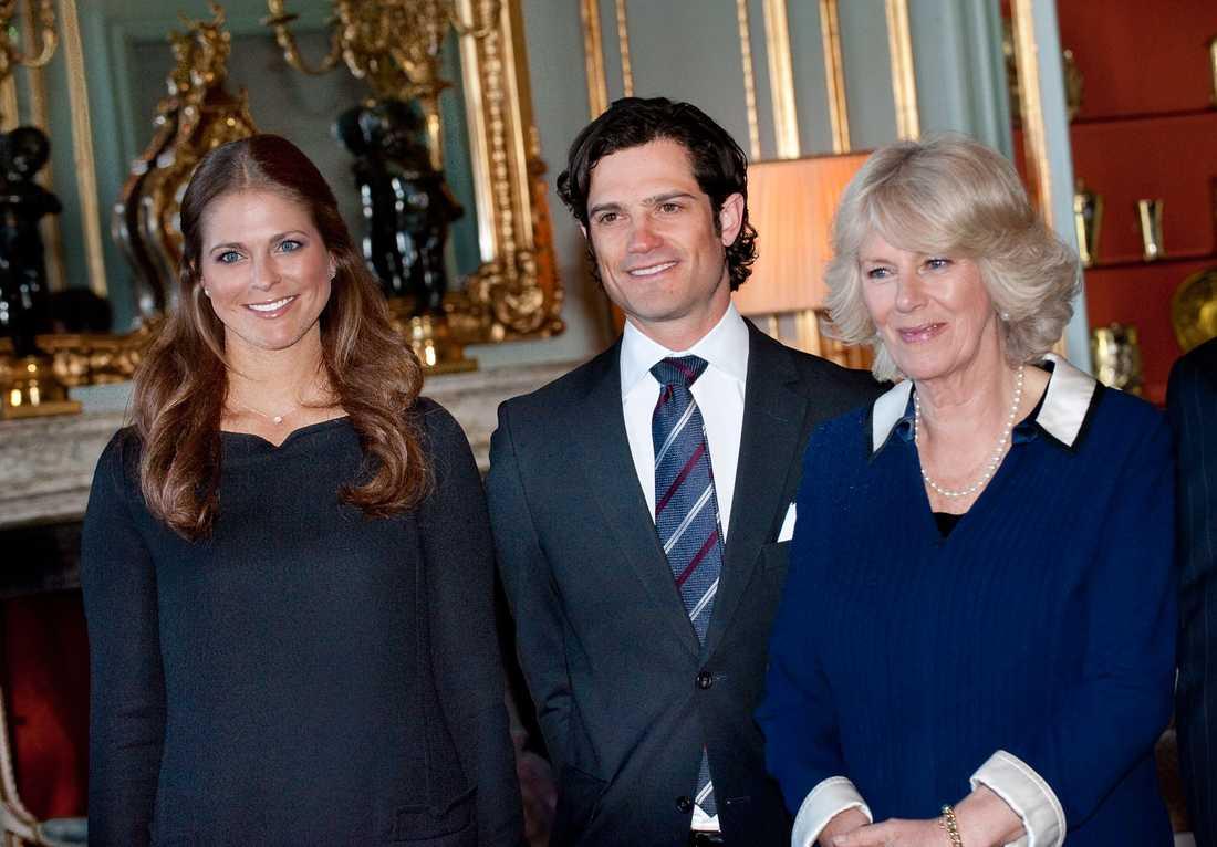 Prinsessan Madeleine, prins Carl Philip och Camilla.