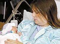 Kellie Lees, 32, nyfödda dotter, Allison, får aldrig träffa sin far Dan Lee. Han fanns ombord på ett av de kapade plan som flög in i World Trade Center.