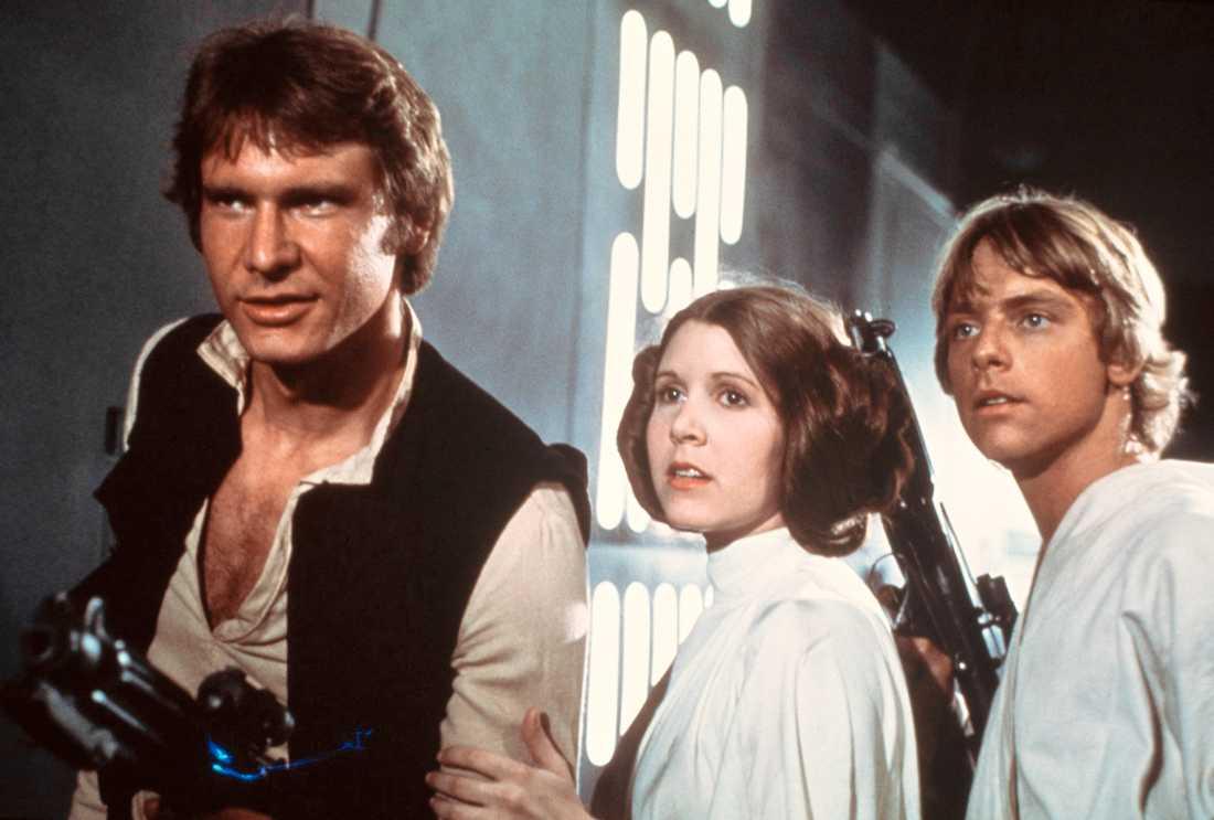 Harrison Ford, Carrie Fisher som prinsessan Leia och Mark Hamill som Luke Skywalker o Star Wars 1977.