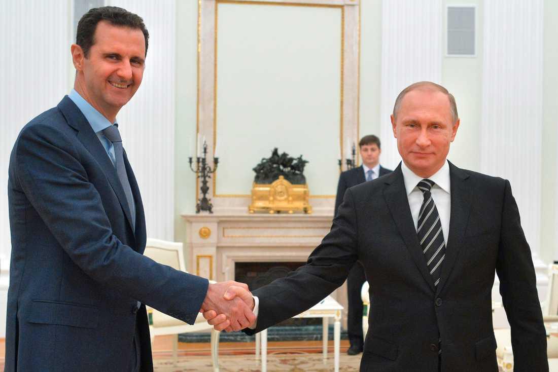 Syriens president Bashar al- Assad och Rysslands president Vladimir Putin.