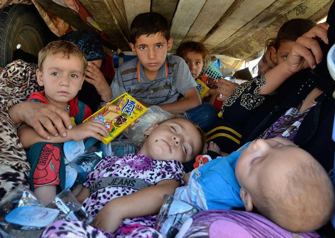 Människor på flykt undan IS framfart.