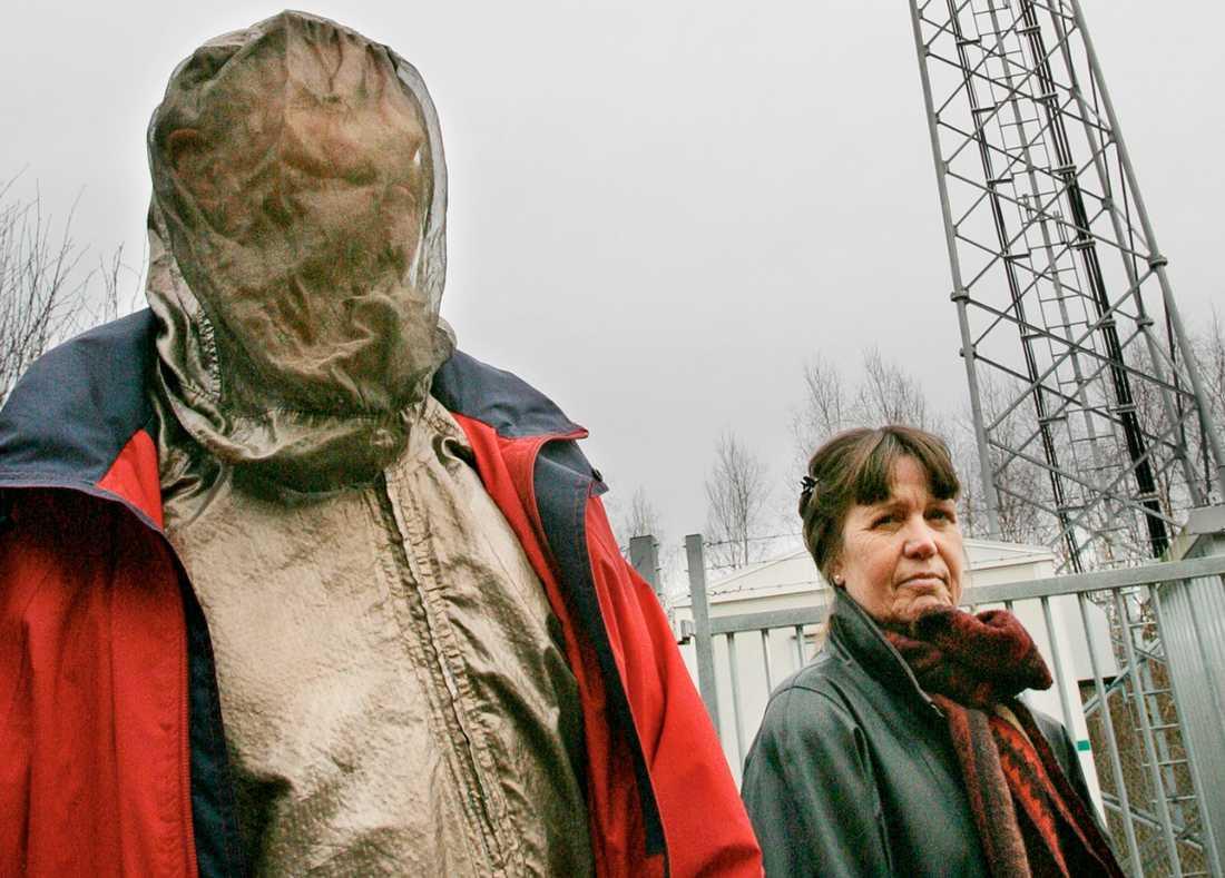Dan Bengtsson, iklädd skyddskläder, och hustrun Kersten.