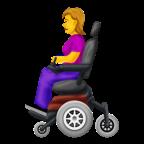 Kvinna i elektrisk rullstol.