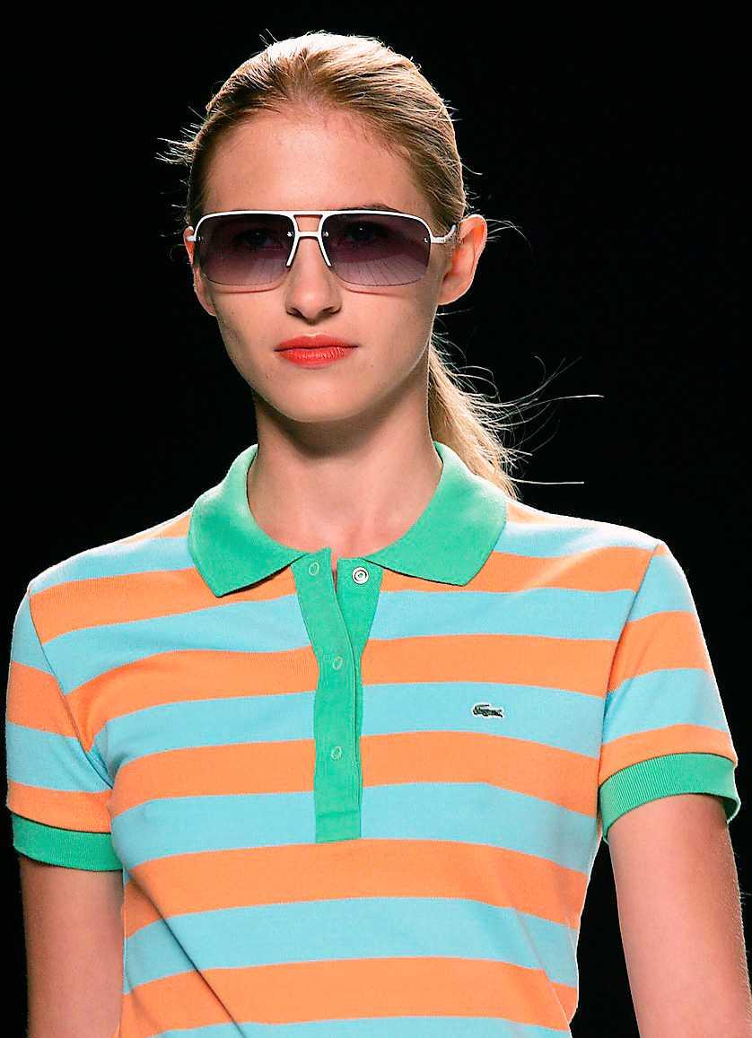 Lacoste Lacoste tillverkar allt från  parfym till kläder och är kanske mest känt för sina pikétröjor. Märket visar ofta upp sig på modeveckor i Frankrike som  här 2005.