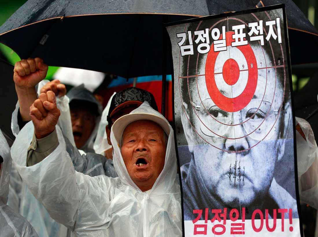 Protester i Sydkorea mot Nordkorea och Kim Jong Il.