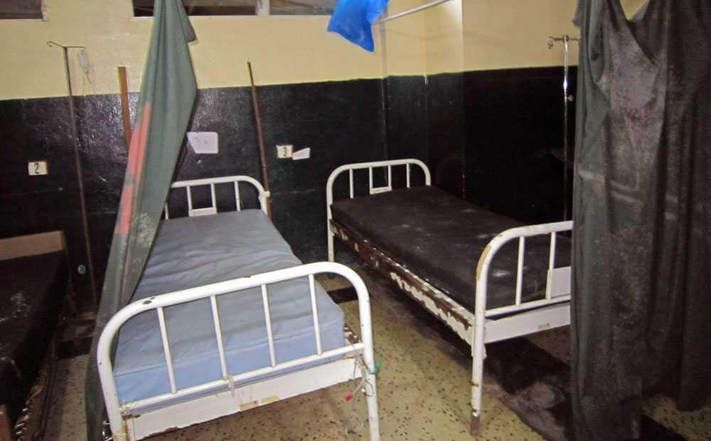 Tomma sängar på ett sjukhus i Liberia 17 juni i år. Sjukhuspersonal och patienter har flytt sjukhuset på grund av ebolavirusets spridning.