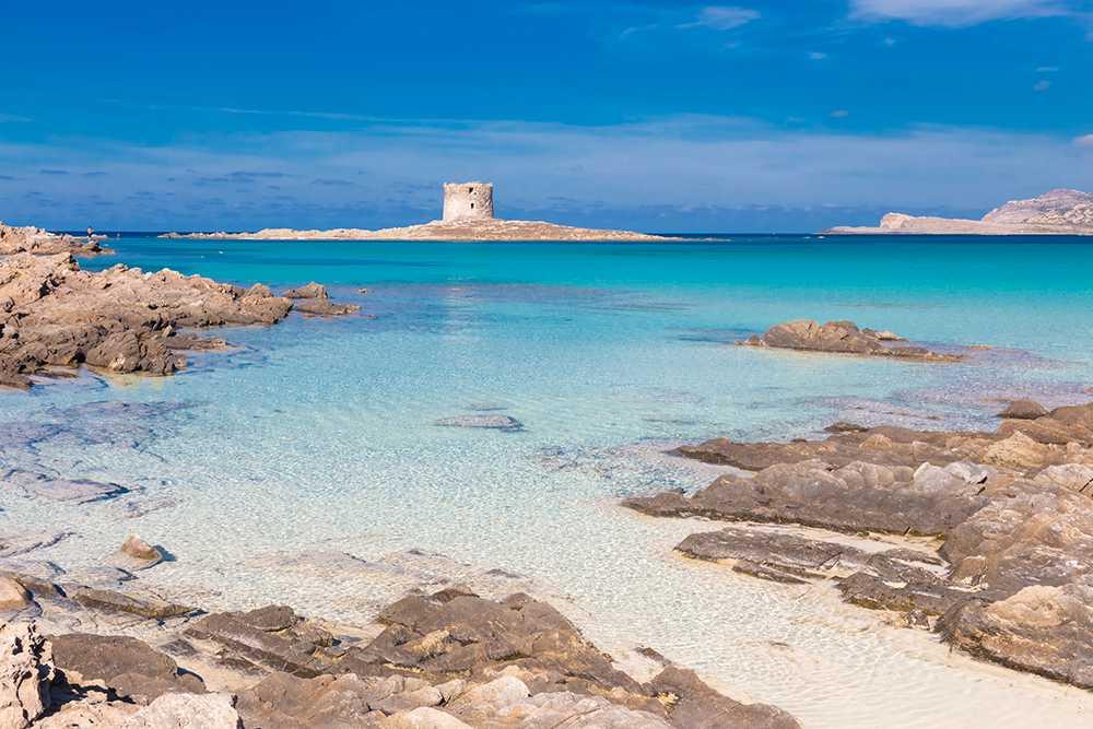 Stranden La Pelosa på Sardinien rankas som en av Italiens finaste.