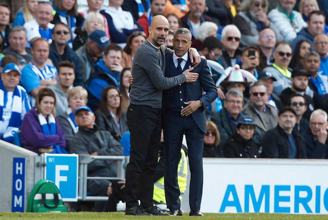 Chris Hughton tillsammans med Pep Guardiola.